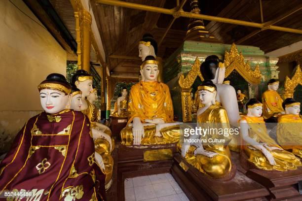 Statues of Buddha in Shwedagon Pagoda, Yangon, Myanmar