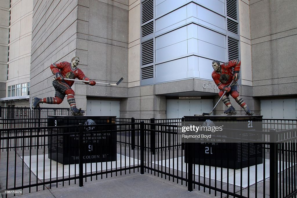 Statues of former Chicago Blackhawks hockey players Bobby Hull and Stan Mikita, sits outside the United Center in Chicago, Illiinois on AUGUST