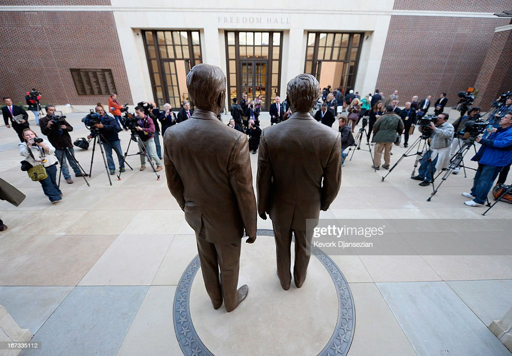 Statues of former Presidents George W. Bush (R) and his father George H.W. Bush are on display during a tour of the George W. Bush Presidential Center on the campus of Southern Methodist University on April 24, 2013 in Dallas, Texas. Dedication of the George W. Bush Presidential Library is to take place on April 25 with all five living U.S. Presidents in attendance and an expected 8,000 invitation-only guests.