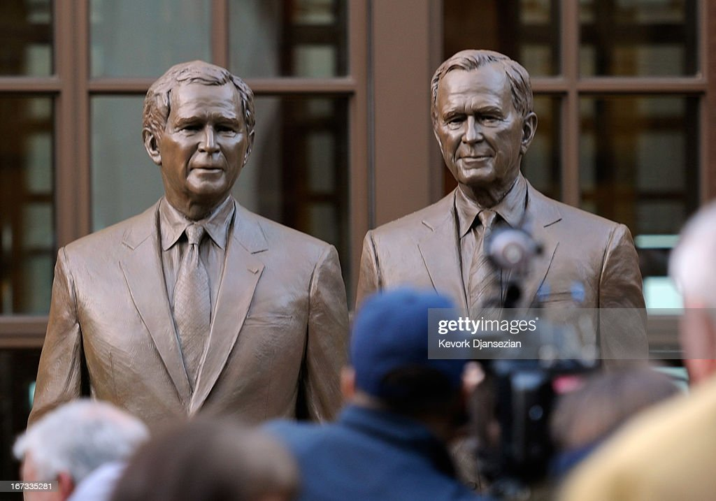 Statues of former Presidents George W. Bush (L) and his father George H.W. Bush are on display during a tour of the George W. Bush Presidential Center on the campus of Southern Methodist University on April 24, 2013 in Dallas, Texas. Dedication of the George W. Bush Presidential Library is to take place on April 25 with all five living U.S. Presidents in attendance and an expected 8,000 invitation-only guests.