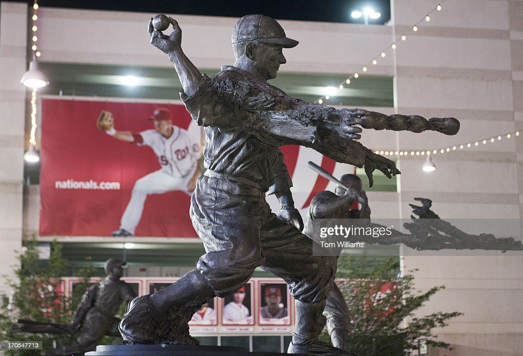 Statues of former Washington baseball players Walter Johnson, center, Frank Howard, right, and Josh Gibson appear near the centerfield gate at Nationals Park. Current National Adam LaRoche appears on a banner in the background.