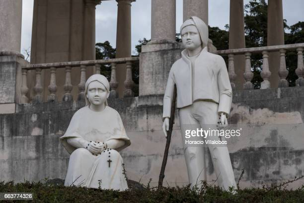 Statues of Jacinta and Francisco Martos at the Sanctuary of Fatima on March 31 2017 in Fatima Portugal Thousands of pilgrims and worshippers visit...