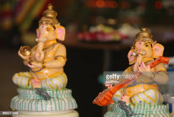 Statues of Lord Ganesh at a Tamil Hindu Temple in Toronto Ontario Canada The statue in the foreground depicts Lord Ganesh playing the veena