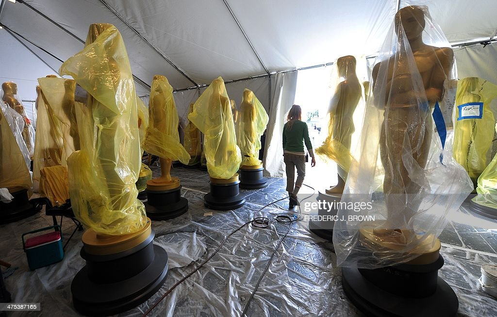 Statues of the Oscars remain in a tent before being transported to the red carpet and Dolby Theatre amid continuing preparations along Hollywood Boulevard on February 27, 2014 in Hollywood, California, for the 86th Academy Awards which takes place on Sunday, March 2. AFP PHOTO/Frederic J. BROWN