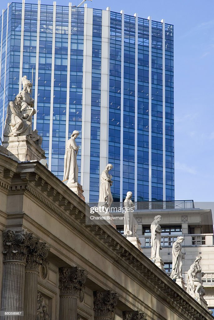 Statues on top of  royal exchange building in England