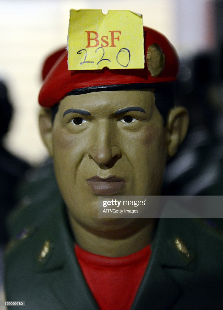 A statuette depicting Venezuelan President Hugo Chavez is seen on display at a shop in Caracas on January 7, 2012. The church weighed in with four days to go before President Hugo Chavez, who is in Cuba recovering from cancer surgery, is supposed to be sworn in to a new six year term. Venezuela's Catholic church warned the government Monday it would be 'morally unacceptable' to override the constitution amid an intensifying crisis over Chavez's health. His vice president has argued that the swearing in can be delayed indefinitely, calling it a 'formality,' and that Chavez's current administration can continue in office until a new one can be sworn in. AFP PHOTO/Leo RAMIREZ