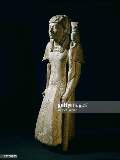 Statuette identified as either a priest of Hathor or of Mut wife of the God Amun found in the court of the temple of Amun at Karnak Dating from the...