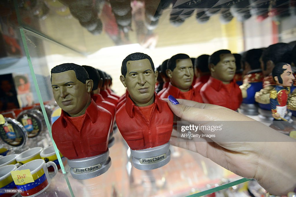 Statuettes depicting Venezuelan President Hugo Chavez are seen on display at a shop in Caracas on January 7, 2012. The church weighed in with four days to go before President Hugo Chavez, who is in Cuba recovering from cancer surgery, is supposed to be sworn in to a new six year term. Venezuela's Catholic church warned the government Monday it would be 'morally unacceptable' to override the constitution amid an intensifying crisis over Chavez's health. His vice president has argued that the swearing in can be delayed indefinitely, calling it a 'formality,' and that Chavez's current administration can continue in office until a new one can be sworn in. AFP PHOTO/Leo RAMIREZ