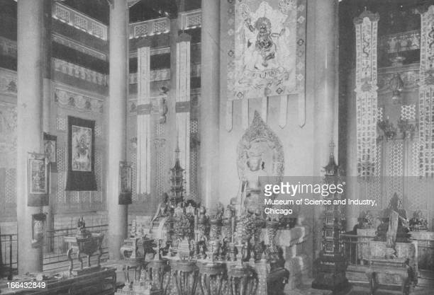 Statures of the Buddha and other icons line the interior of the Lama Temple of Jehol at the Century of Progress International Exposition in Chicago...