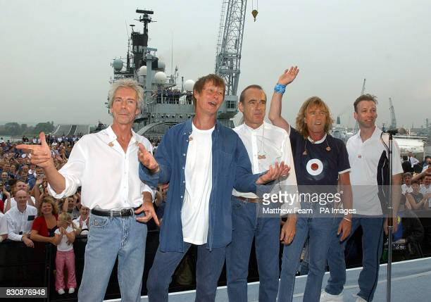 Status Quo Andrew Bown John 'Rhino' Edwards Francis Rossi Rick Parfitt and Matt Letley at the end of their concert for fans and sailors on board the...