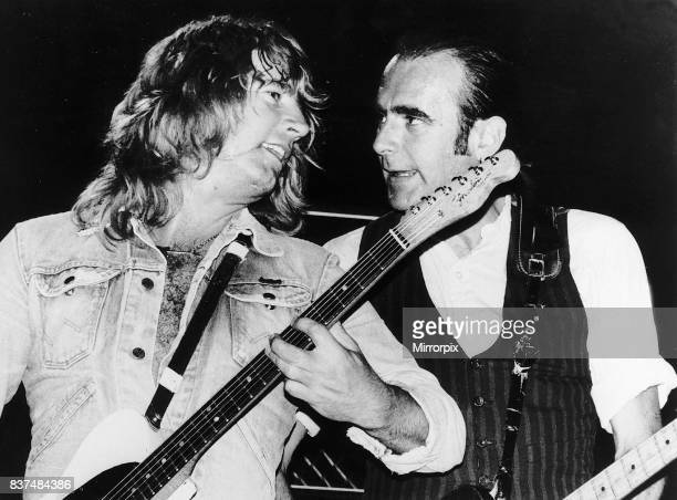 Status Quo POP Group Rick Parfitt and Francis Rossi singing on stage