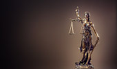 Statute of Justice. Bronze statue Lady Justice holding scales and sword.
