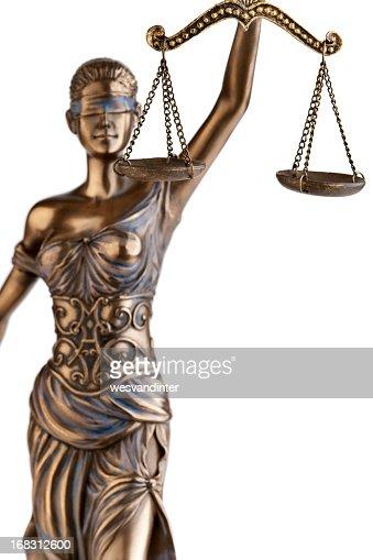 A statute of Themis holding a balance