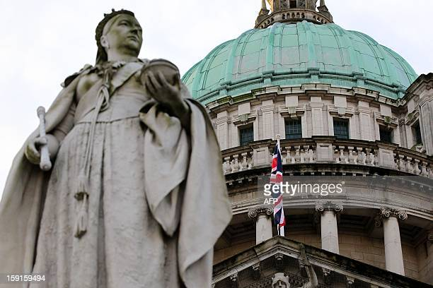 A staute of Queen Victoria stands in front of the union flag at Belfast City Hall in Belfast Northern Ireland to mark the Duchess of Cambridge's 31st...