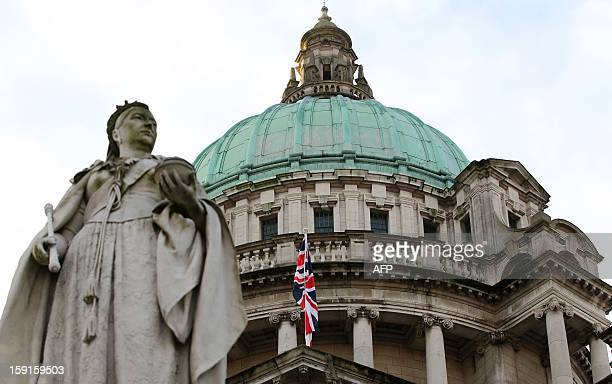 A staute of Queen Victoria stands in front of the union flag at Belfast City Hall in Belfast Northern Ireland hoisted to mark the Duchess of...