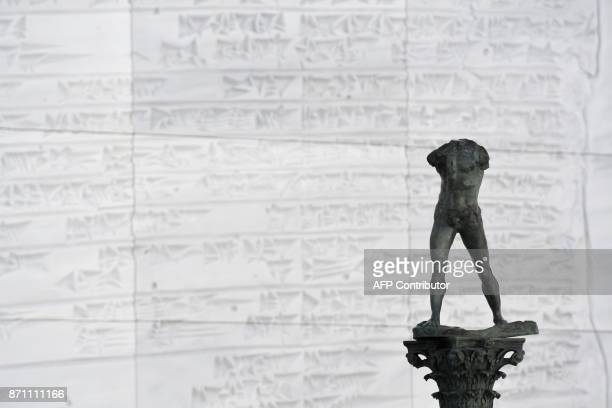 A staute of 'Walking Man On a Column' of Auguste Rodin made in 2006 by Fonderie Coubertin is displayed in a gallery at the Louvre Abu Dhabi Museum...