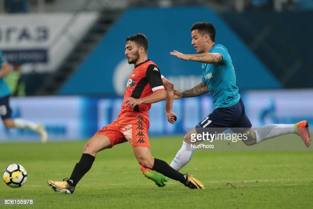 Stav Finish of FC Bnei Yehuda and Sebastian Driussi of FC Zenit Saint Petersburg vie for the ball during the UEFA Europa League match Third...