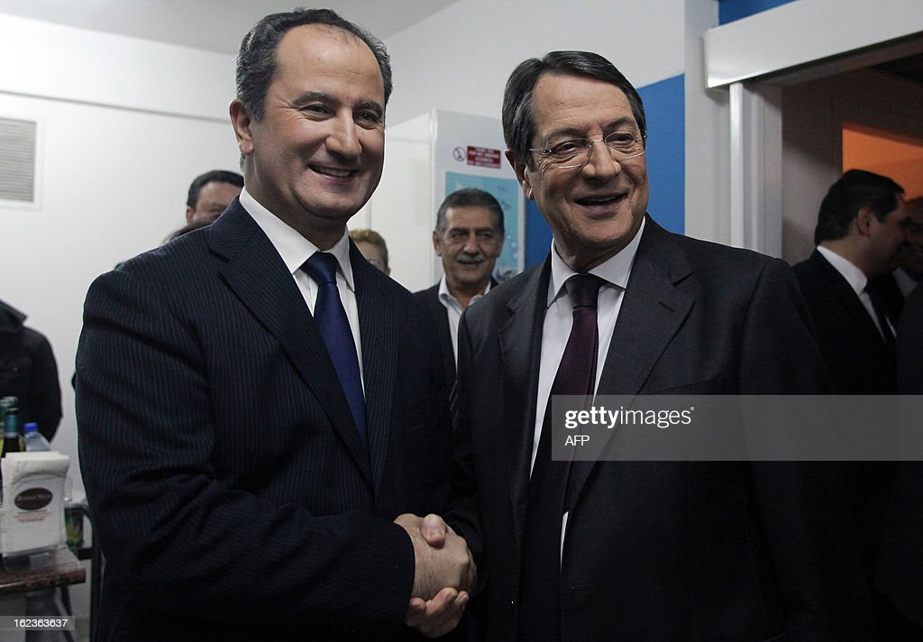 Stavros Malas (L) and Nikos Anastasiadis (R), the two remaining candidates in the Cypriot presidential election, pose for a picture before the last televised political debate in Nicosia, on February 22, 2013 ahead of the scheduled elections on February 24.