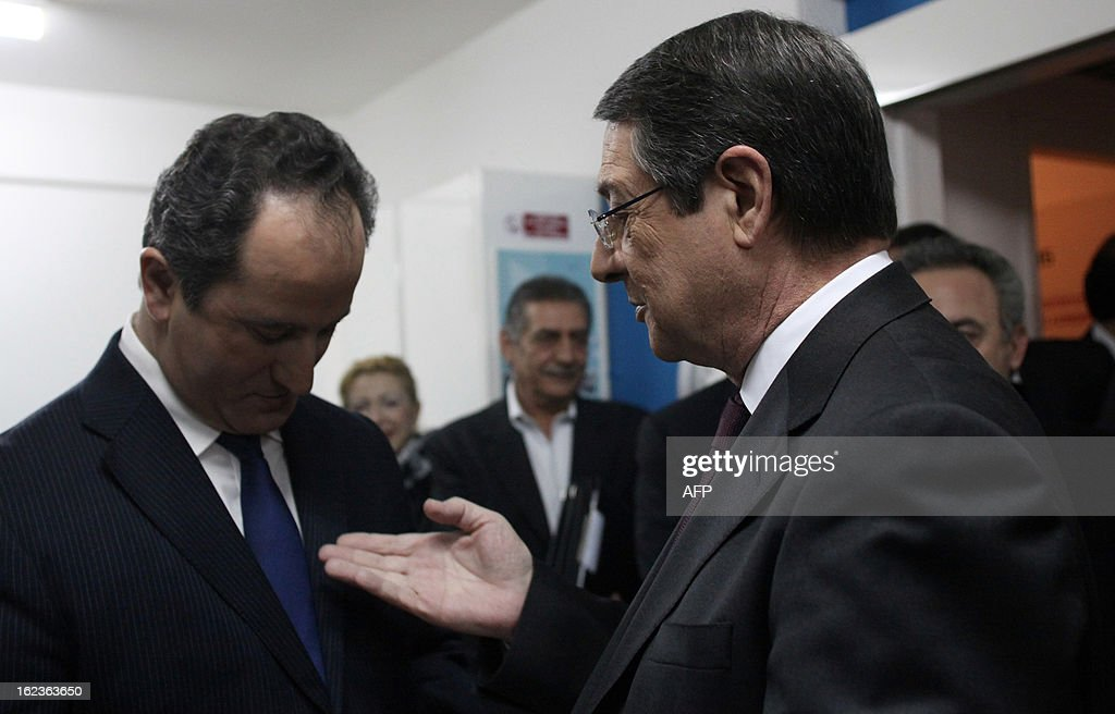 Stavros Malas (L) and Nikos Anastasiadis (R), the two remaining candidates in the Cypriot presidential election, talk before the last televised political debate in Nicosia, on February 22, 2013 ahead of the scheduled elections on February 24.
