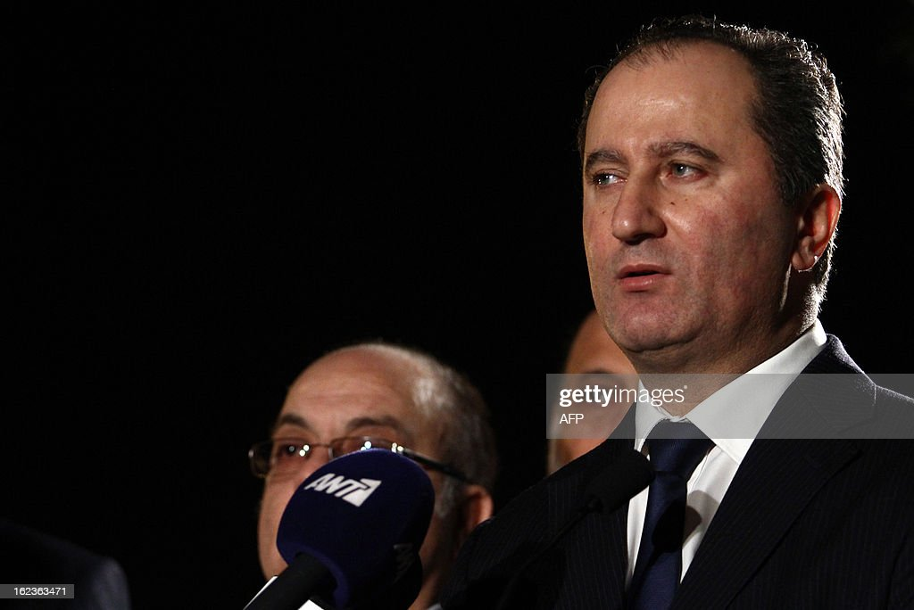 Stavros Malas (R), one of the two remaining candidates in the Cypriot presidential election, speaks to the press prior to the last televised political debate in Nicosia, on February 22, 2013 ahead of the scheduled elections on February 24.