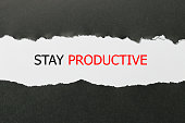 Stay Productive Motivation quote written behind a torn paper