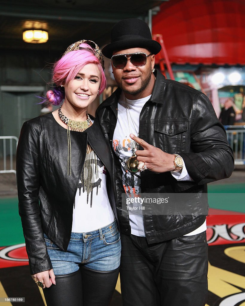 Stayc Reign and <a gi-track='captionPersonalityLinkClicked' href=/galleries/search?phrase=Flo+Rida&family=editorial&specificpeople=4456012 ng-click='$event.stopPropagation()'>Flo Rida</a> pose during day two of the 86th Anniversary Macy's Thanksgiving Day Parade Rehearsals at Macy's Herald Square on November 20, 2012 in New York City.