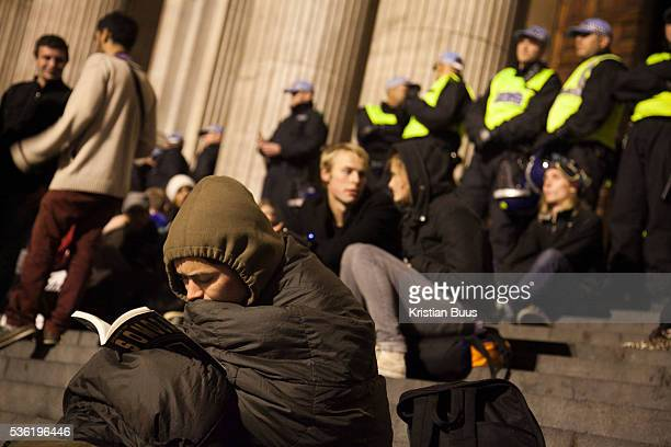 Staying warm reading On the steps of St Paul's CathedralThe London Stock Exchange was attempted occypied in solidarity with Occupy Wall in Street in...