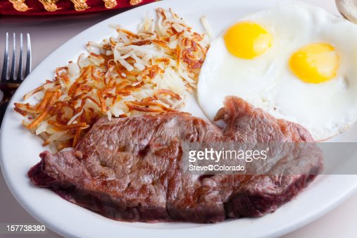 Steak, eggs sunnyside up and hashbrowns for breakfast