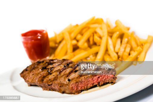 Steak, ketchup and french fries on a plate