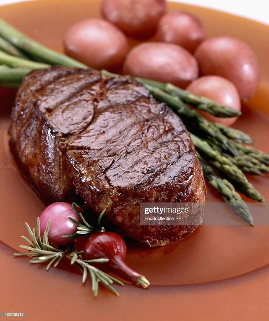 Steak served with asparagus and potatoes : Stock Photo