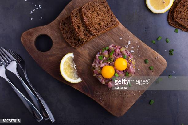 Steak tartare  served with quail egg yolks