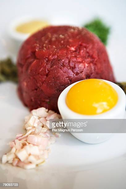 Steak tartare with egg and onions.
