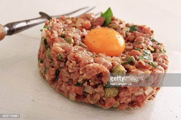 steak tartare with quail egg yolk