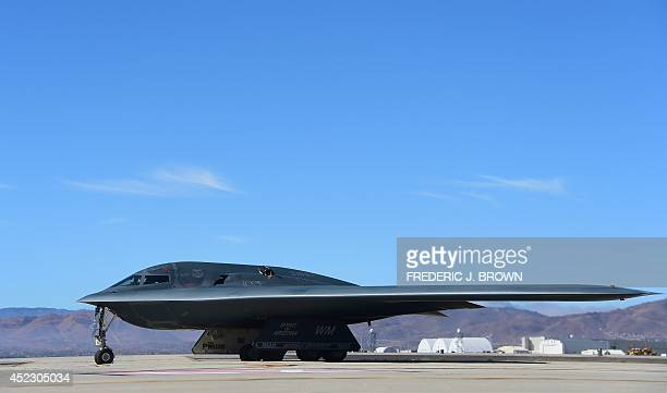 Stealth Bomber pulls up on the runway after landing at the Palmdale Aircraft Integration Center of Excellence in Palmdale California on July 17 where...