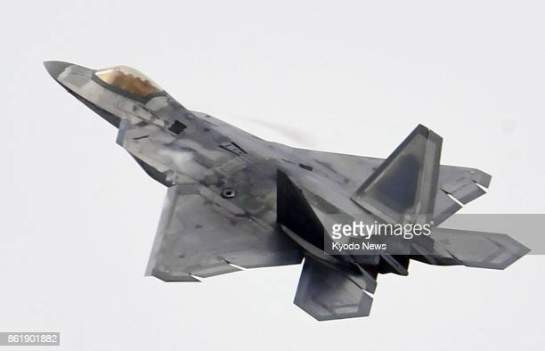 A US F22 stealth fighter is shown to the media at an airport on the outskirts of Seoul on Oct 16 before participating in the Seoul International...