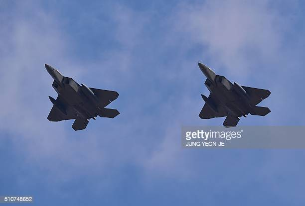 US F22 stealth fighters fly over Osan Air Base in Pyeongtaek south of Seoul on February 17 2016 The radarevading aircraft flew across South Korea on...