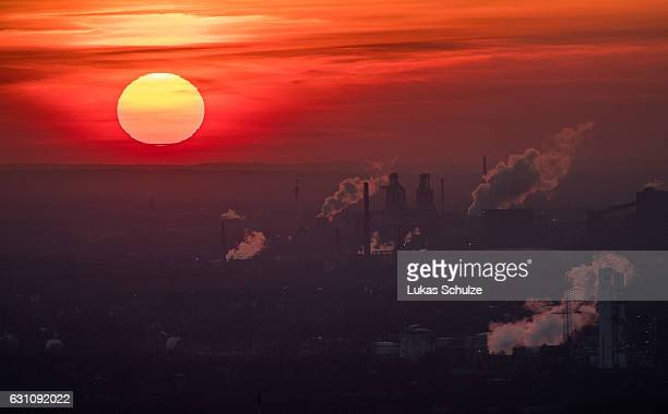 Steam and exhaust rise from different companies on a cold winter day on January 6 2017 in Oberhausen Germany According to a report released by the...