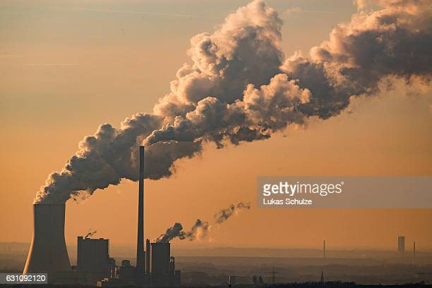 Steam and exhaust rise from the power plant of STEAG on a cold winter day on January 6 2017 in Oberhausen Germany According to a report released by...