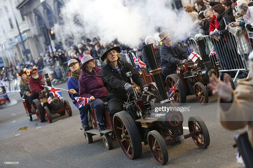 Steam and traction engine enthusiasts take part in the New Year's Day Parade in central London on January 1, 2013. London bade farewell to a golden year of Olympic and royal spectaculars with a fireworks extravaganza over the River Thames that welcomed in 2013. AFP PHOTO / JUSTIN TALLIS