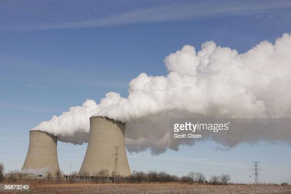 Steam billows from the cooling towers at Exelon's nuclear power generating station February 17 2006 in Byron Illinois Elevated levels of radioactive...