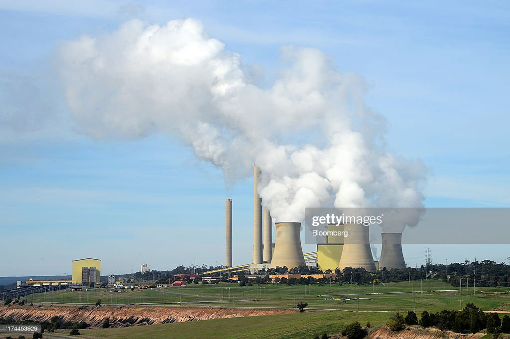 Steam billows from the cooling towers at the Loy Yang A coal-fired power station, operated by AGL Energy Ltd., front, and Loy Yang B coal-fired power station, co-owned by GDF Suez Australian Energy and Mitsui & Co., rear, on the outskirts of Traralgon, Australia, on Thursday, July 25, 2013. Australian Prime Minister Kevin Rudd will cut spending and limit tax concessions to fund a move to emissions trading a year ahead of schedule, should his Labor government win this year's election. Photographer: Carla Gottgens/Bloomberg via Getty Images