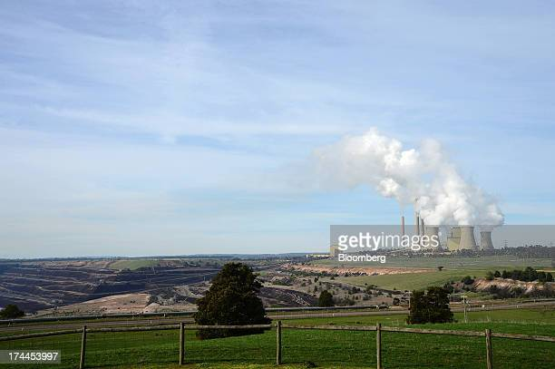 Steam billows from the cooling towers at the Loy Yang A coalfired power station operated by AGL Energy Ltd front and Loy Yang B coalfired power...