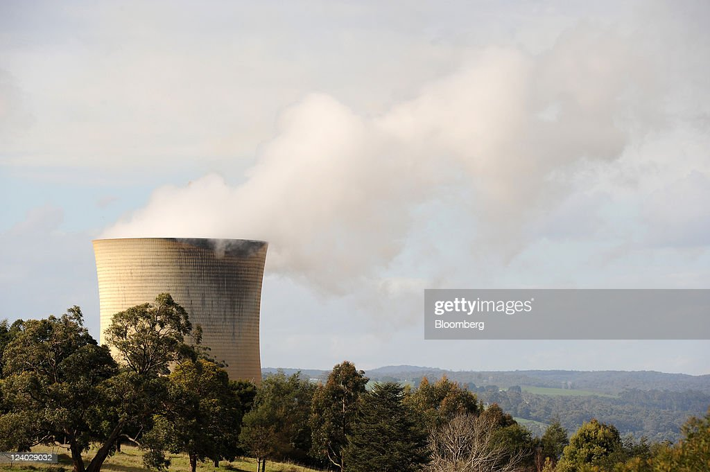 Steam billows from the cooling towers of TRUenergy Holdings Pty's Yallourn coal-fired power station in the Latrobe Valley, Australia, on Wednesday, Sept. 7, 2011. Australian prime minister Julia Gillard's plan to make factories and utilities either cut the nation's greenhouse gases or pay for pollution-curbing programs abroad may force companies to buy an average 66 million metric tons of credits a year starting in 2015, sending prices up 28 percent. Photographer: Carla Gottgens/Bloomberg via Getty Images