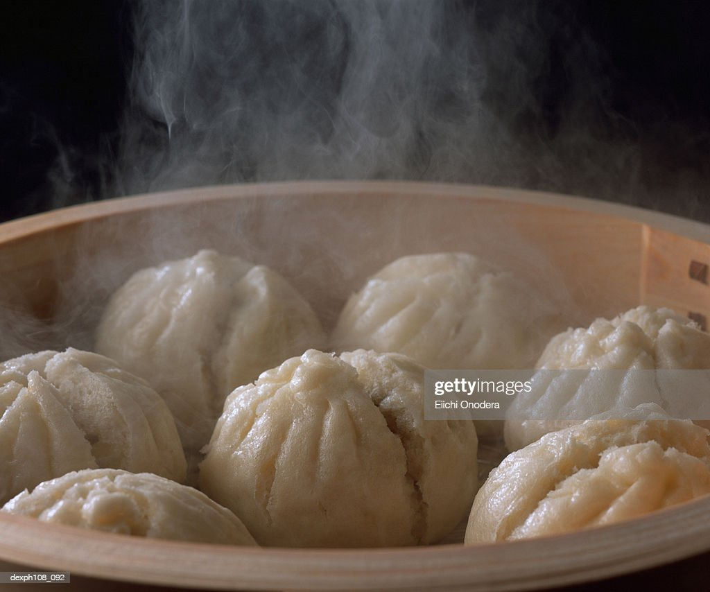 Steam buns in bamboo basket, close-up : Stock Photo
