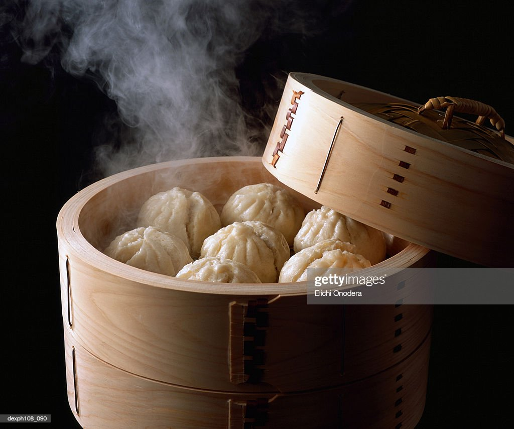 Steam buns in bamboo basket : Stock Photo