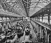 """Steam engine trains in an erecting shop in Derby. Heavy industry inside a train yard in Derby from the pre-1900 book """"English Illustrated Magazine"""" 1891-1892."""
