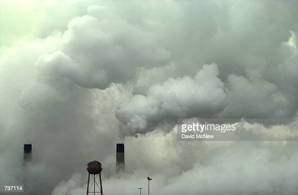 Steam envelops the Etiwanda Generating Plant January 26 2001 as a cold front brings low temperatures to Rancho Cucamonga CA dumping snow on nearby...