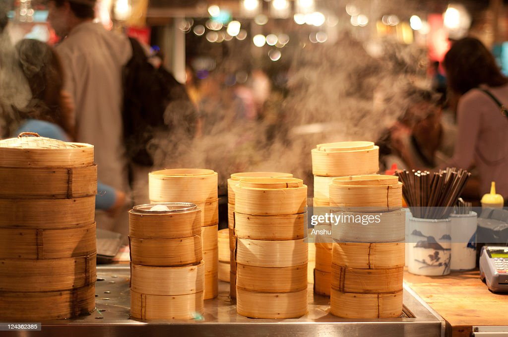 Steam from Bamboo steamer in market : Stock Photo