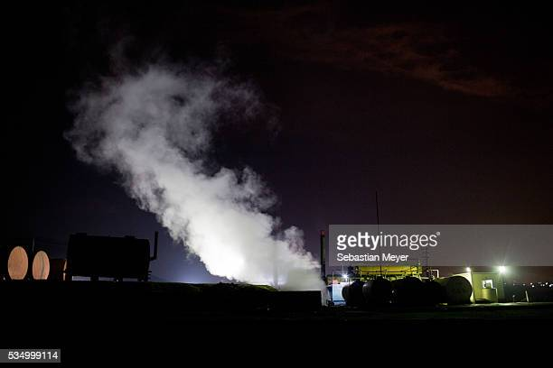 Steam from the cooling bank rises above the refinery The family of Yezidis displaced from Sinjar live next to an oil refinery in the Kurdish Region...