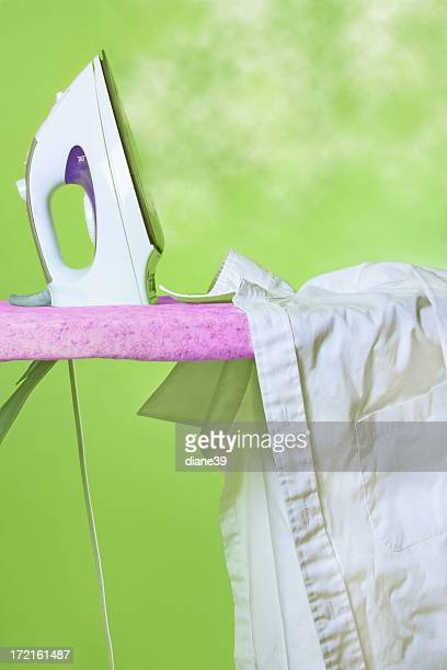 Steam iron on an ironing board